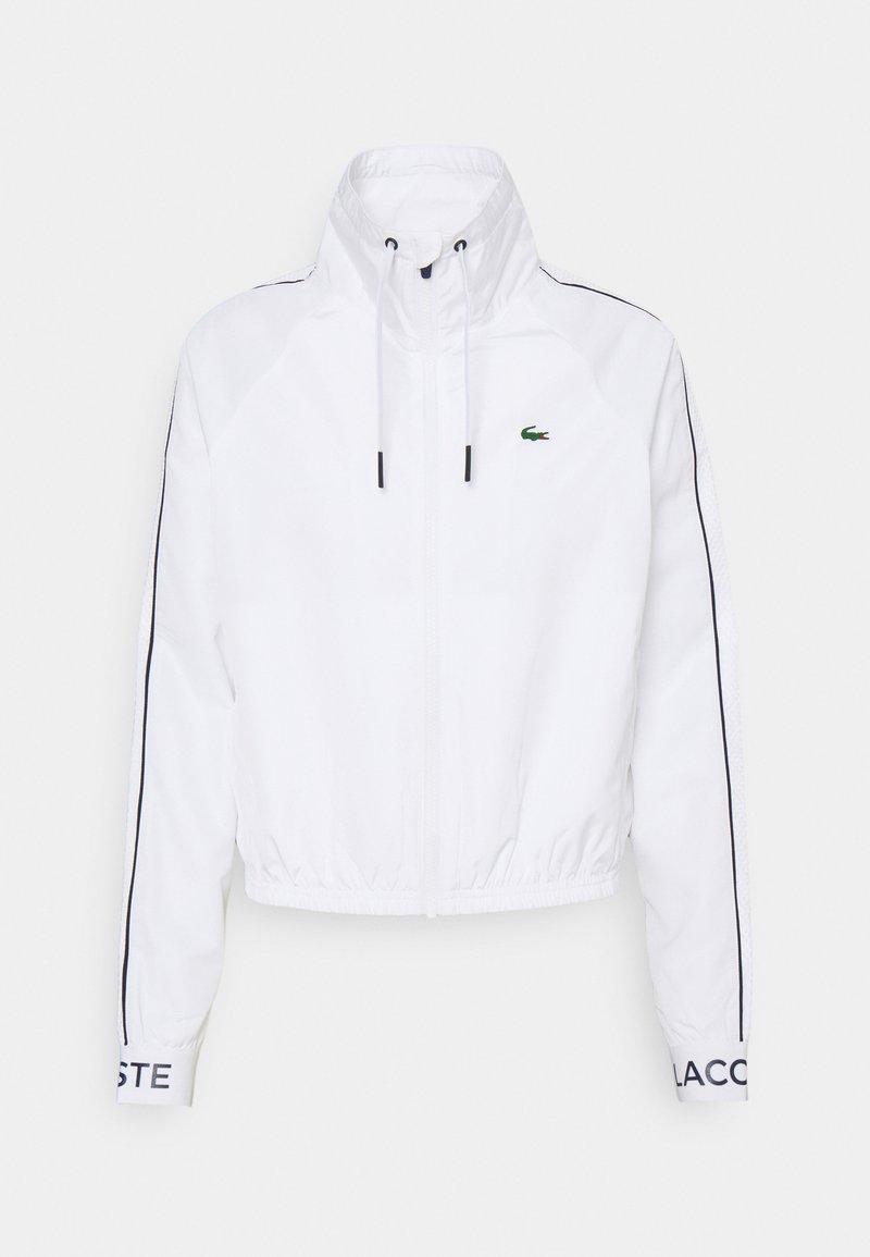 Lacoste Sport - TRACKJACKET - Training jacket - white/navy blue