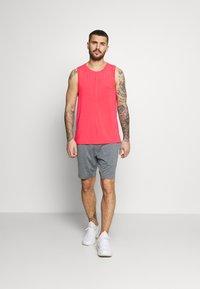 Nike Performance - TANK  - Camiseta de deporte - light fusion red/black - 1