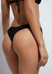 Calzedonia - BRAZaILIAN MIT HOHEM BEINAUSSCHNITT AUDREY - Bikini bottoms - nero - 1