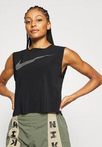 Nike Performance - RUN TANK PLEATED - Sports shirt - black/reflective black - 5