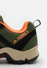 adidas Performance - TERREX AX2R - Hiking shoes - wild pine/core black/screaming orange - 5
