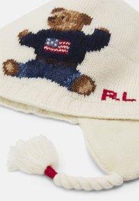 Polo Ralph Lauren - BEAR EARFLAP APPAREL ACCESSORIES UNISEX - Čepice - ivory - 2