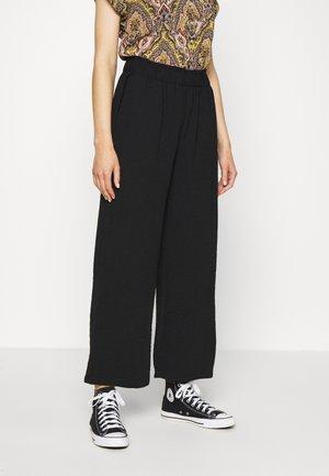JDYTINA - Spodnie materiałowe - black