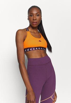 HAIDA - Medium support sports bra - orange pop