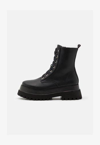 HARLOW - Platform ankle boots - black