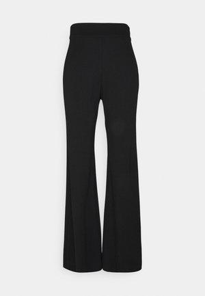 SIBEL  - Trousers - black