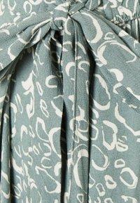 Vero Moda - VMLIVA MINI WRAP SKIRT - Mini skirt - laurel wreath/liva - 5