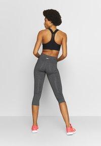 Reebok - LUX 3/4 - 3/4 sports trousers - dark grey - 2