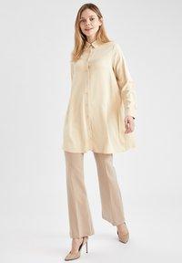 DeFacto - Button-down blouse - beige - 1