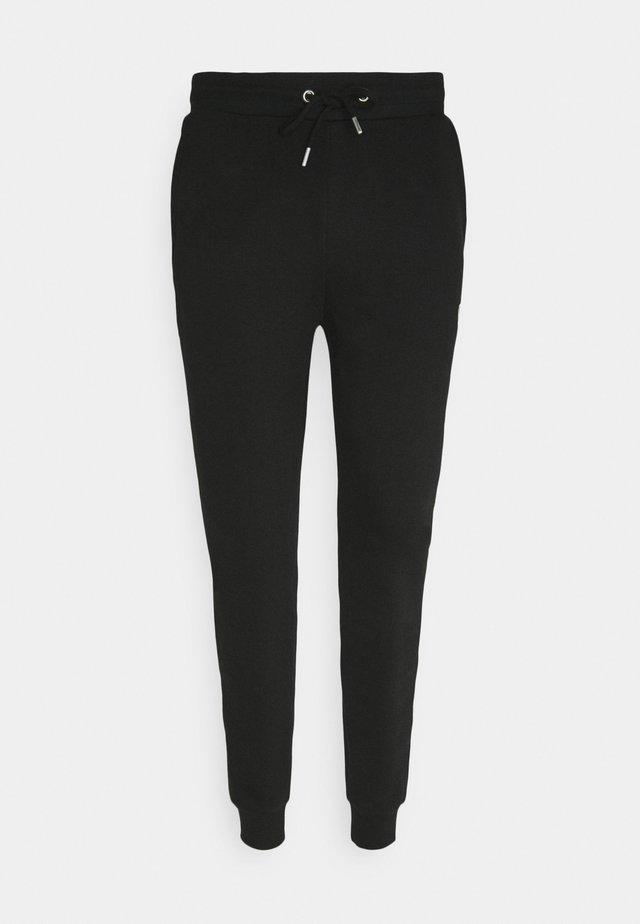 ECO JOGGER - Pantalon de survêtement - black