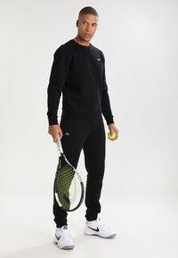 Lacoste Sport - Spodnie treningowe - black - 1