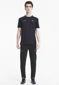 Puma - Trainingsbroek -  black - 1
