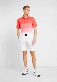adidas Golf - Funkční triko - real coral/white - 1