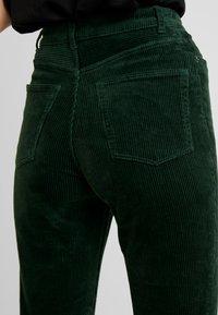 Monki - KIMMY TROUSERS - Trousers - green - 4