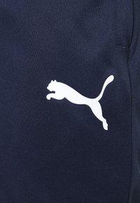 Puma - TEAMLIGA TRAINING PANTS - Jogginghose - peacoat/white - 6