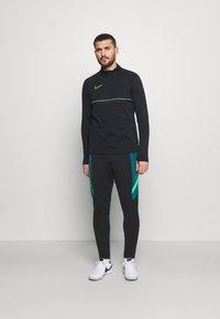 Nike Performance - DRY ACADEMY PANT  - Tracksuit bottoms - black/dark teal green/green strike - 1