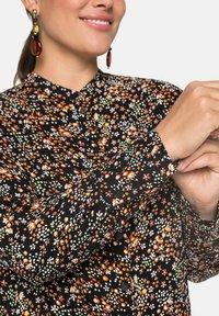 Sheego - Button-down blouse - schwarz bedruckt - 3
