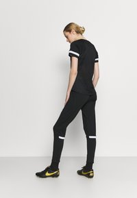 Nike Performance - PANT - Pantalon de survêtement - black/white - 2