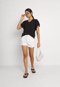 Vero Moda - VMNADS TRAPEZ SLEEVE - Print T-shirt - black - 1