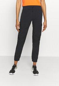 Peak Performance - HIT PANT - Trousers - black - 0
