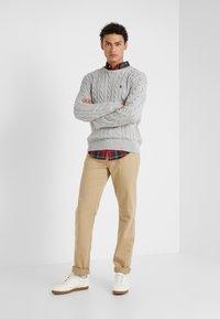 Polo Ralph Lauren - VARICK - Trousers - luxury tan - 1