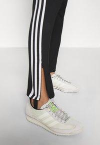 adidas Originals - 70S PANT - Leggings - Trousers - white/black - 3