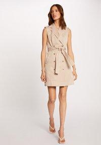 Morgan - BUTTONED SLEEVELESS WRAP  - Shirt dress - beige - 1