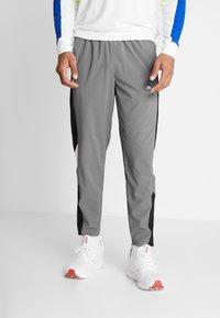Puma - REACTIVE PACKABLE PANT - Outdoor trousers - castlerock black/white - 0