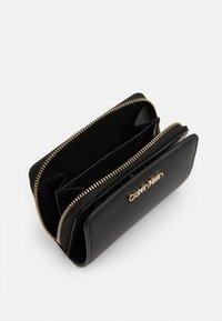 Calvin Klein - WALLET FLAP  - Lommebok - black - 3