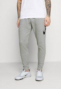 Nike Performance - TAPER - Tracksuit bottoms - dark grey heather/black - 0