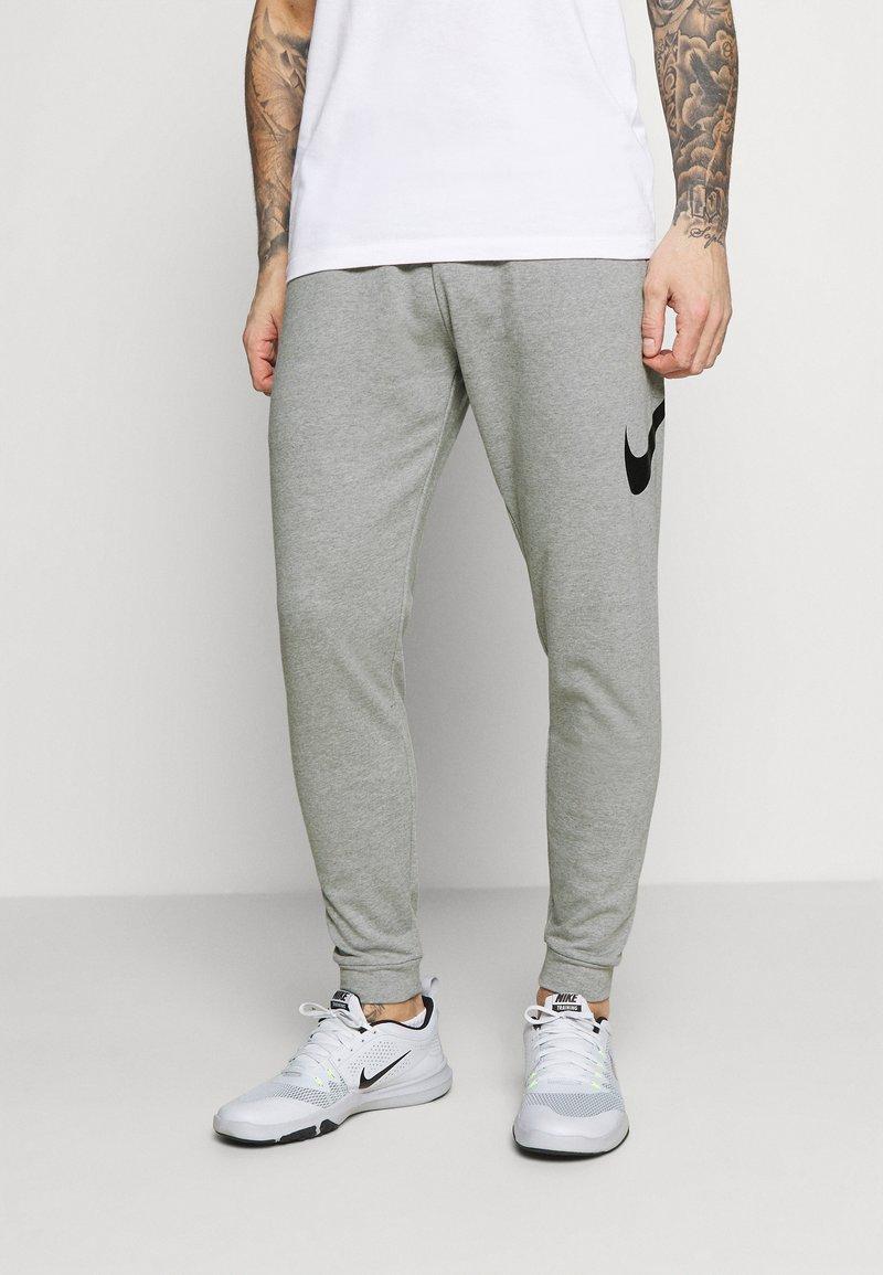 Nike Performance - TAPER - Tracksuit bottoms - dark grey heather/black