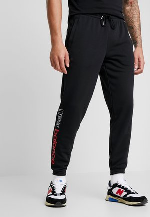 ESSENTAILS ICON - Tracksuit bottoms - black