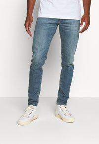 Diesel - D-STRUKT - Jeans Tapered Fit - indigo - 0