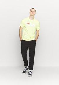 Fila - PURE TEE - Print T-shirt - limelight - 1