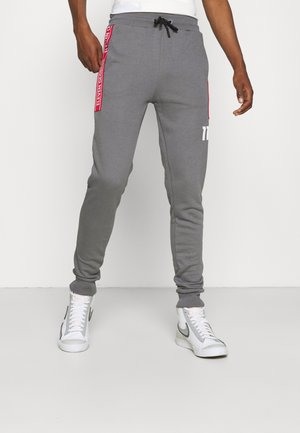 TAPED JOGGERS - Tracksuit bottoms - steel/silver/inferno red