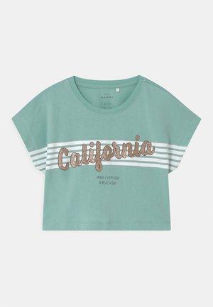 NKFVILMA - T-shirt print - pastel turquoise