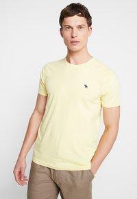 Abercrombie & Fitch - POP ICON CREW - T-shirt basic - popcorn with mood indigo - 0