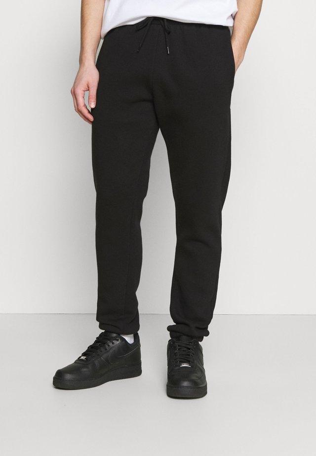 GROWEL MITU - Teplákové kalhoty - black