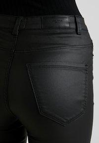 Vero Moda - VMSOPHIA COATED PANTS - Trousers - black - 5