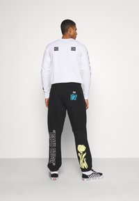 Obey Clothing - TOXIC MIND TOXIC PLANET - Tracksuit bottoms - black - 2