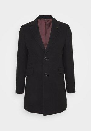 FAUX BUTTON - Short coat - black