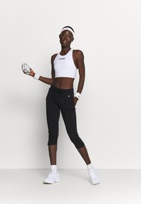 Champion - CAPRI PANTS - Urheilucaprit - black - 1