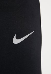 Nike Performance - ESSENTIAL PANT - Tracksuit bottoms - black/reflective silver - 7