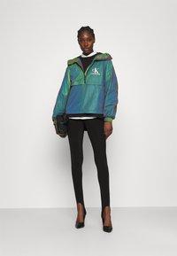 Calvin Klein Jeans - REFLECTIVE POPOVER - Windbreaker - multi coloured - 1