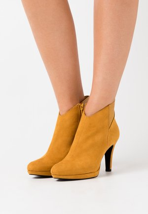 High heeled ankle boots - dark saffron