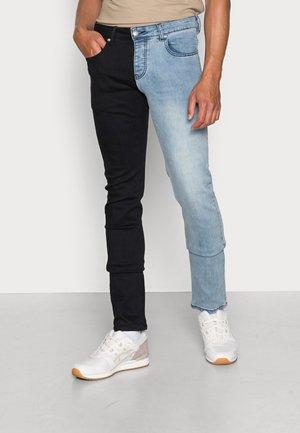 BICOLOR - Slim fit jeans - black/blue