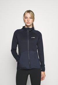 adidas Performance - TERREX TECH LITE HOODED - Fleece jacket - legend ink - 0
