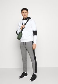 Calvin Klein - SOLID MIX BACK LOGO PANTS - Tracksuit bottoms - grey - 1