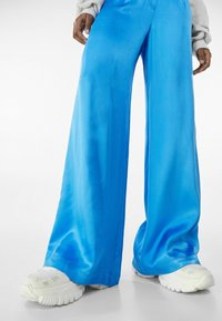 Bershka - Trousers - blue