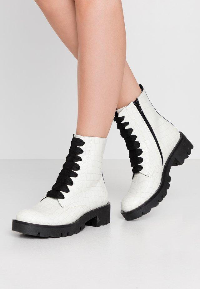 LOREN - Platform ankle boots - bianco